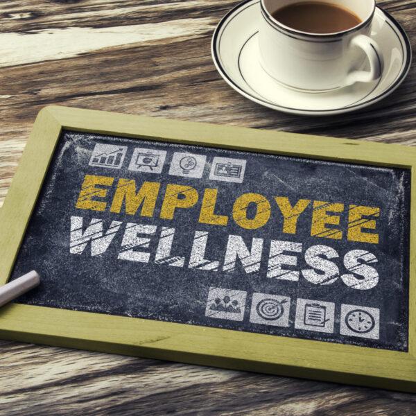 Image of a blackboard with Employee Wellness written on in Chalk